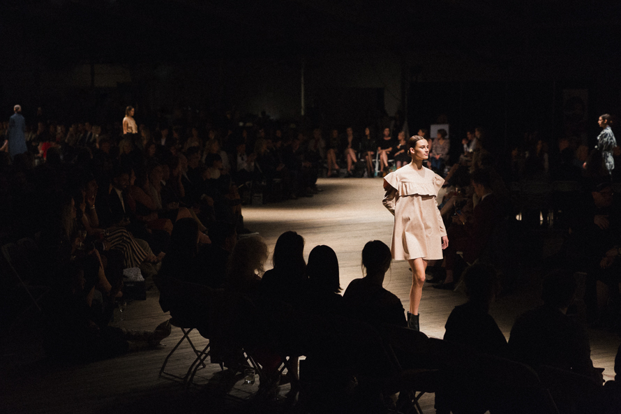 Model walks fashion show runway
