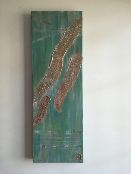 Shown hanging on a wall.
