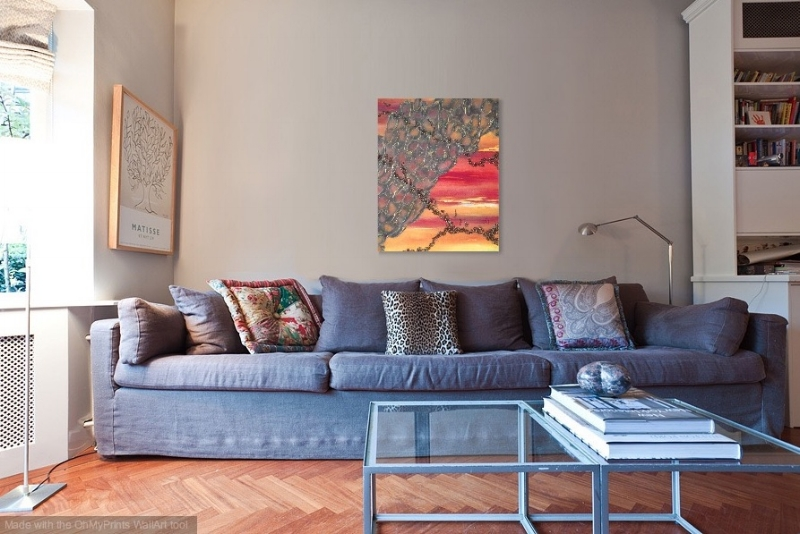 Shown in living room with blue sofa.