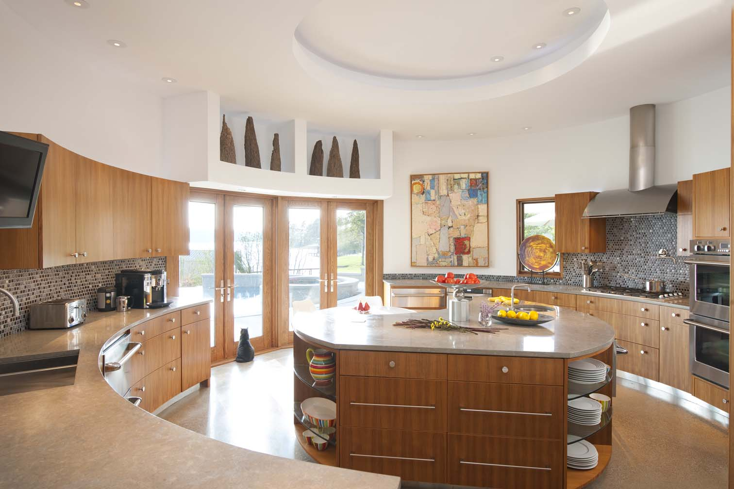 LED circular cove lighting in this round kitchen perfectly accents the circular focal island.