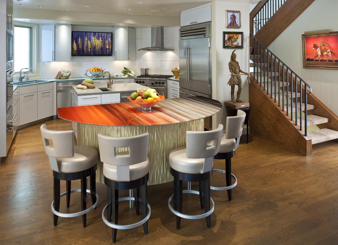 Art photography applied to this kitchen island is highlighted by under counter lighting. The face of the island is covered in custom 3 form material, back-lit with LED lighting for dramatic effect.