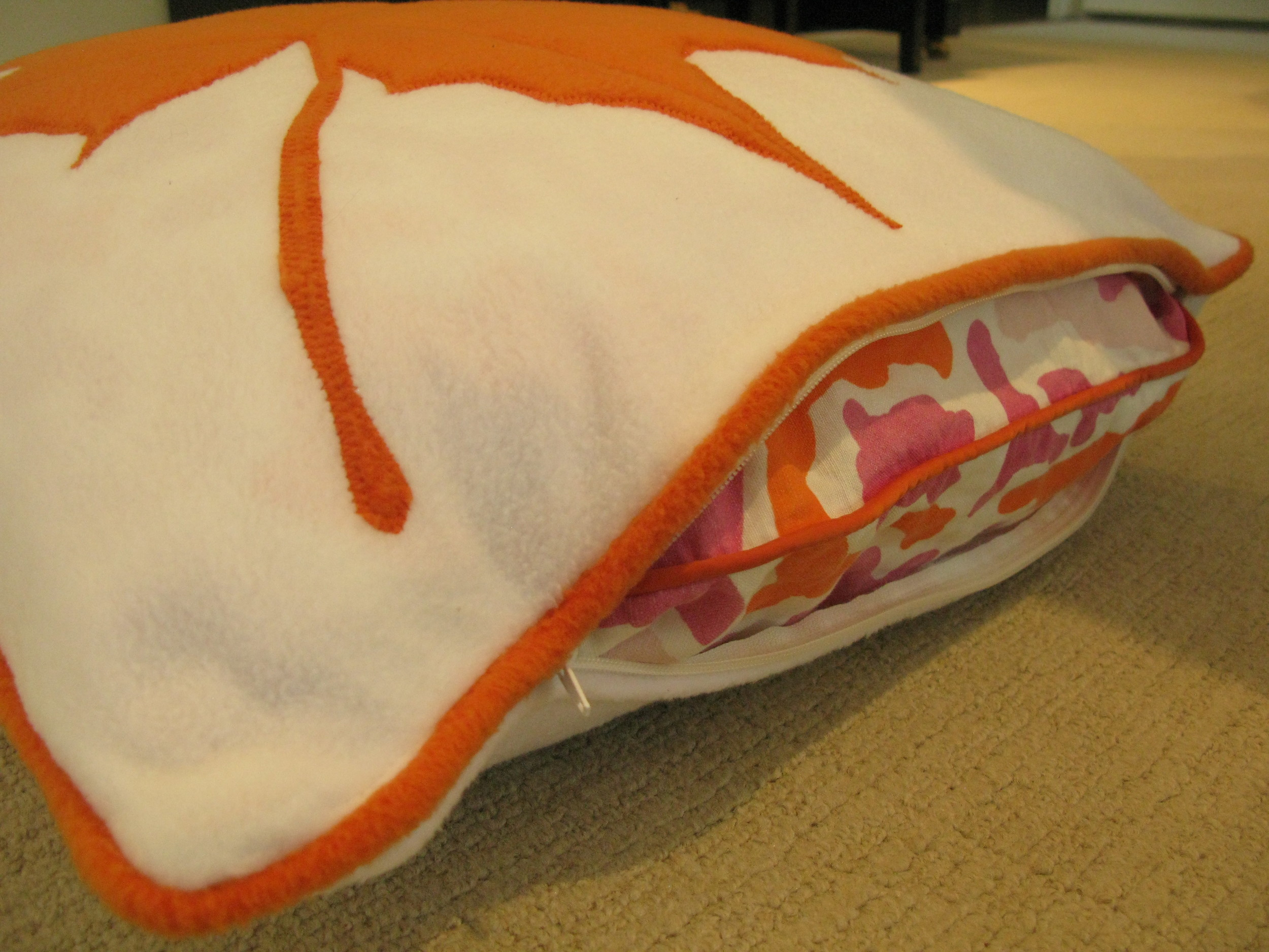 Zippered Fall slipcover easily removed for out of season storage.