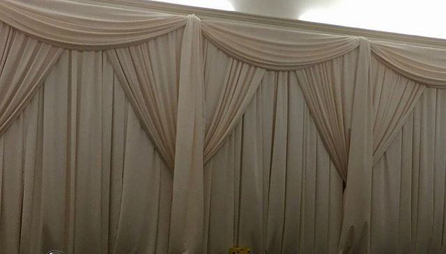 Adding color doesn't mean being harsh. This subtle champagne looks amazing with the added swags. #drape #drapery #pipeanddrape #backdrops #eventdecor #swags #unique #events #uniqueeventelements