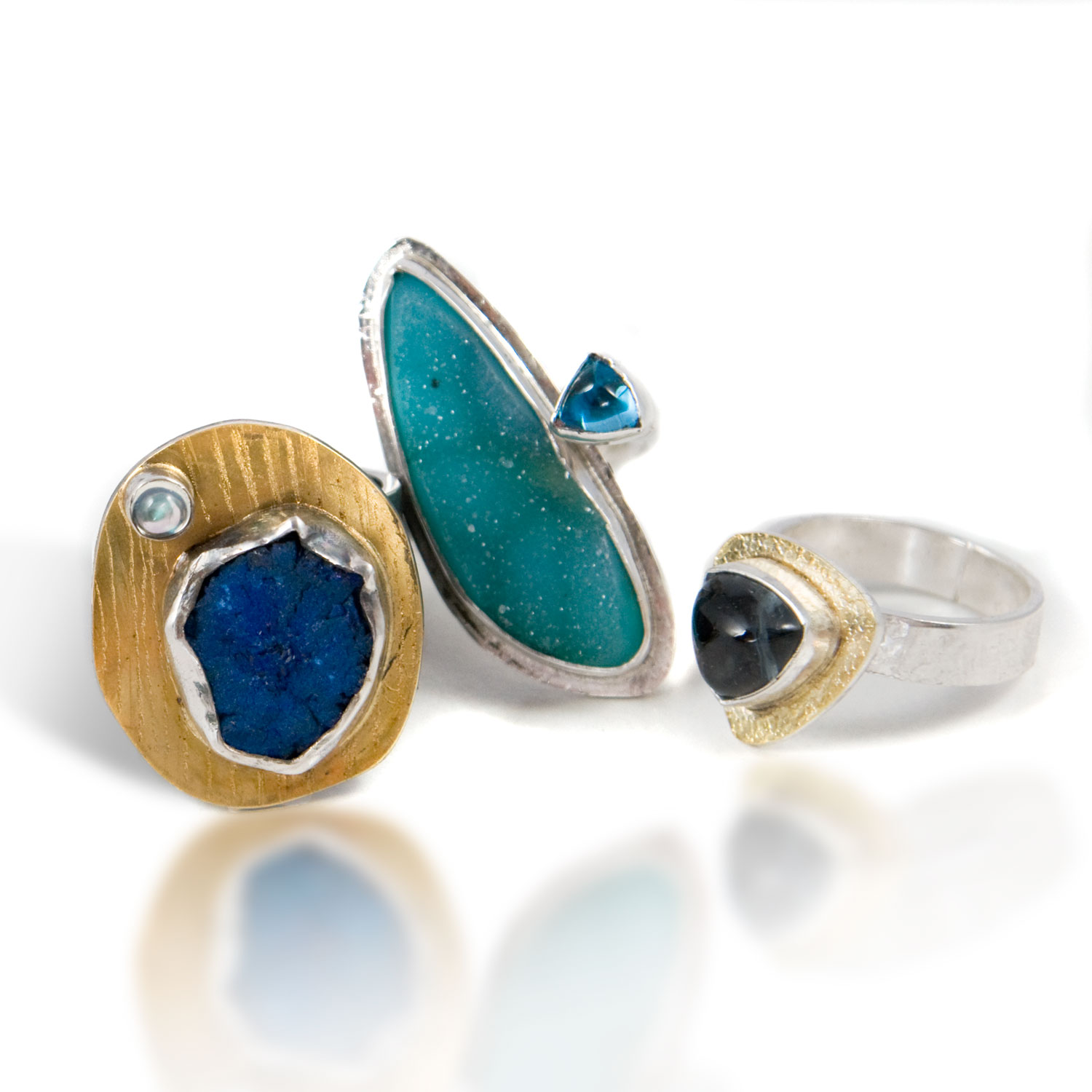 From left to right...azurite and moonstone ring, Ocean dreams ring (drusy and topaz) and Blue Tourmaline trillion ring.