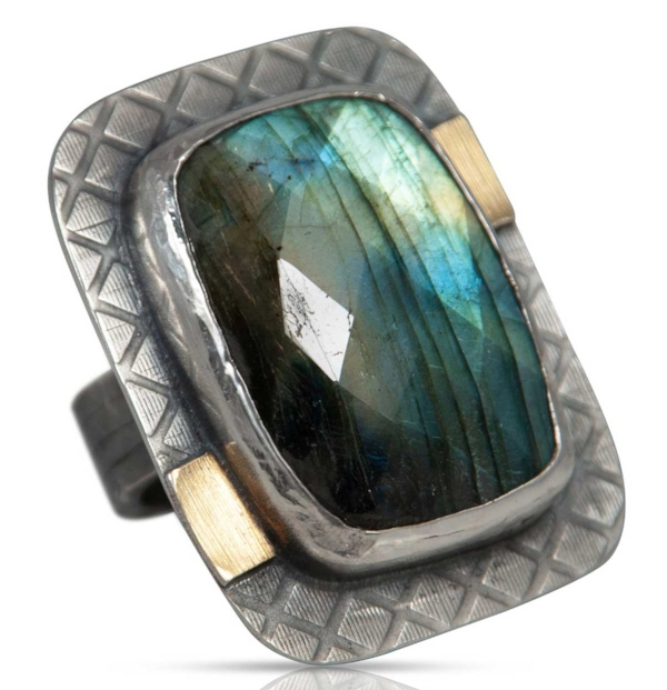 I can't stop looking at  this  beautiful faceted labradorite stone. There is so much flash and color!