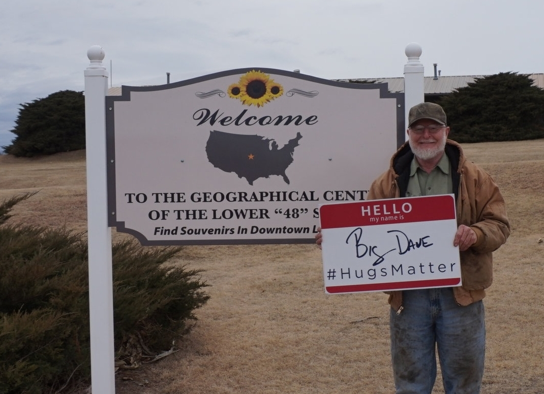 - a man standing with my sign at the heart of the country