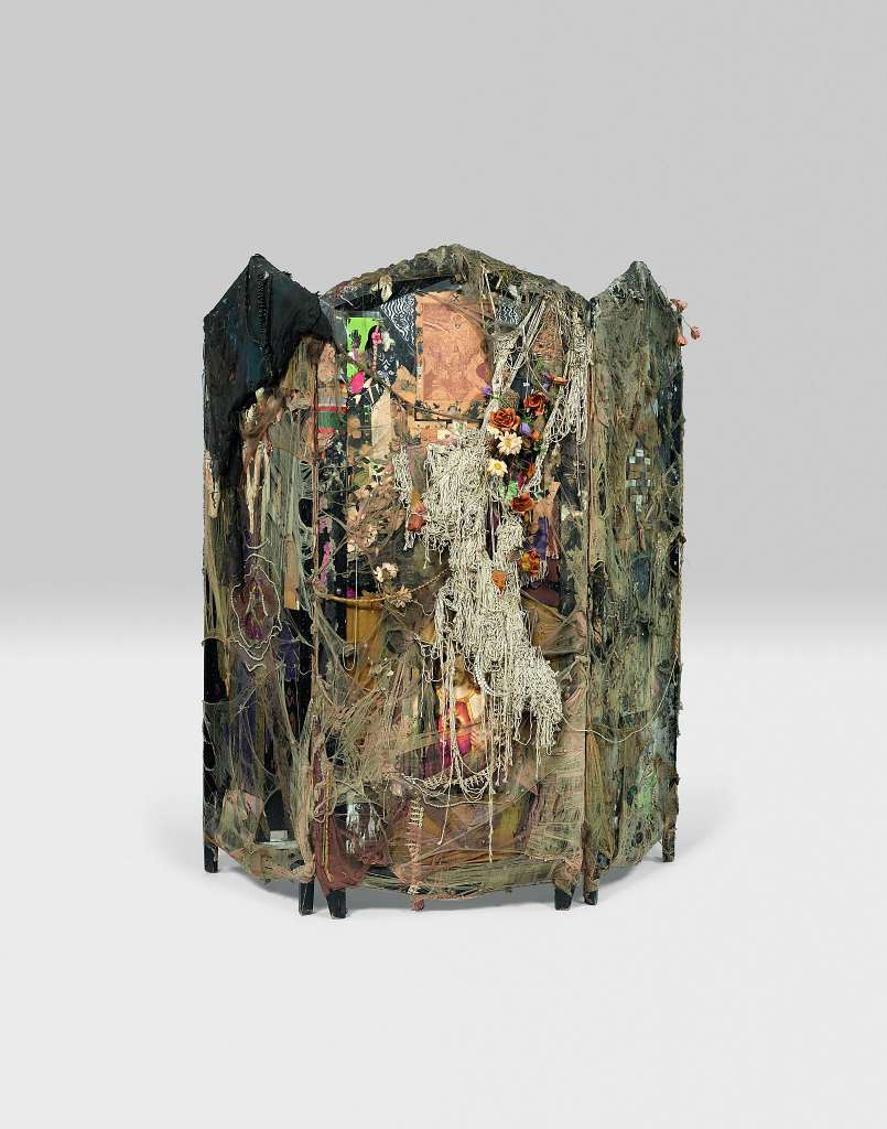 PARTITION (front), 1961-63; wood partition with nylon, fringe, costume jewelry, artificial flowers, fabric, paint, string, straw-hat fragment, metal, mirrors, maraca, paper collage, paper, feathers, metal foil, wax, and tinsel; three panels;Collection Centre Pompidou, Paris, France; © Conner Family Trust, San Francisco, California / Artists Rights Society (ARS), New York, New York
