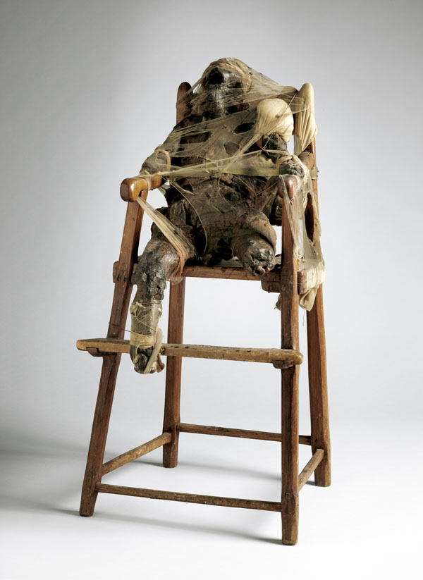 Bruce Conner,  C  HILD , 1959-1960; Wax, nylon, cloth, metal, twine, and high chair; Collection Museum of Modern Art, New York; Gift of Philip Johnson; © Conner Family Trust, San Francisco, California / Artists Rights Society (ARS), New York, New York; Photo: John Wronn.