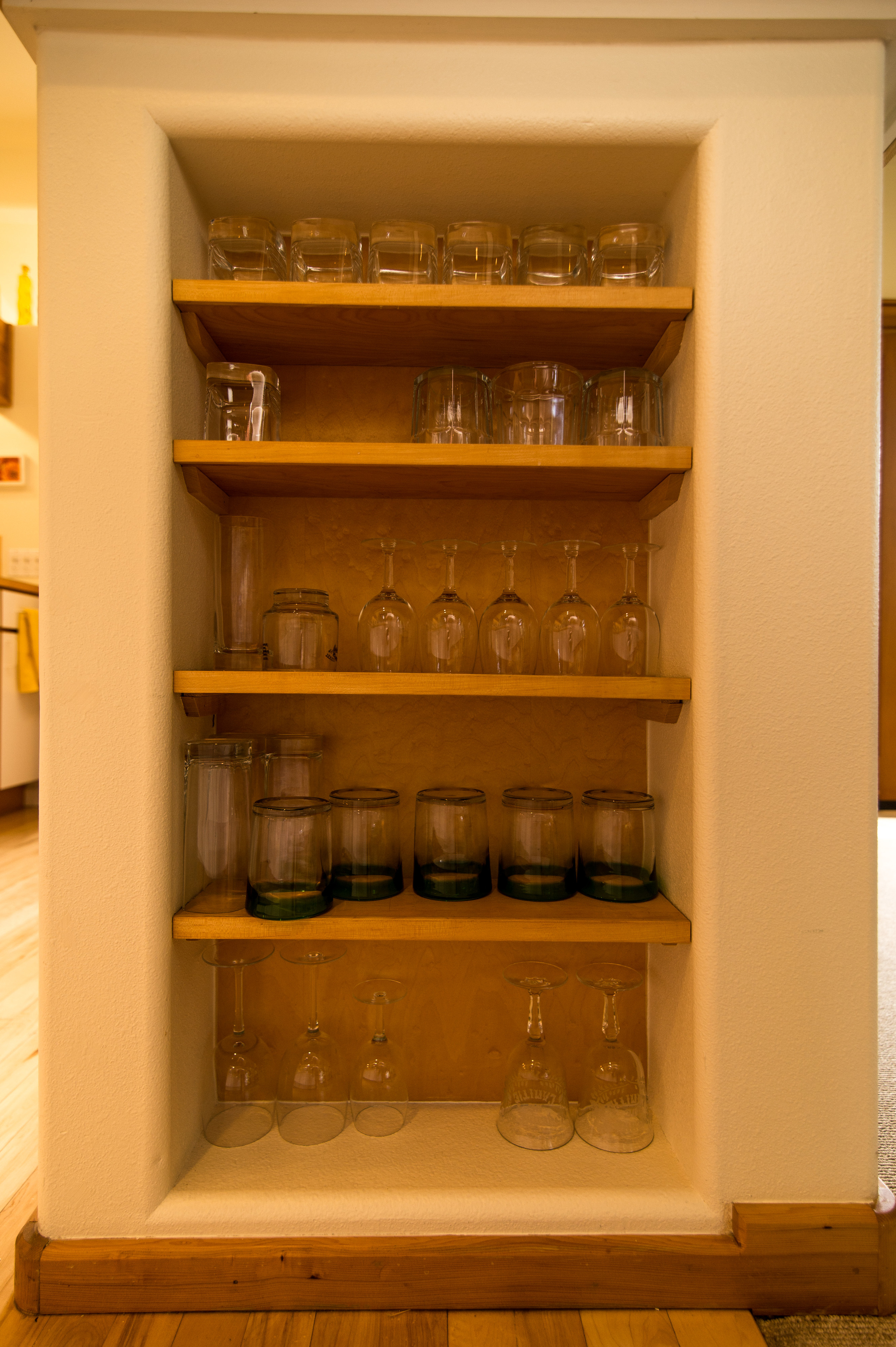 Glass storage framed into end wall of base cabinets.........