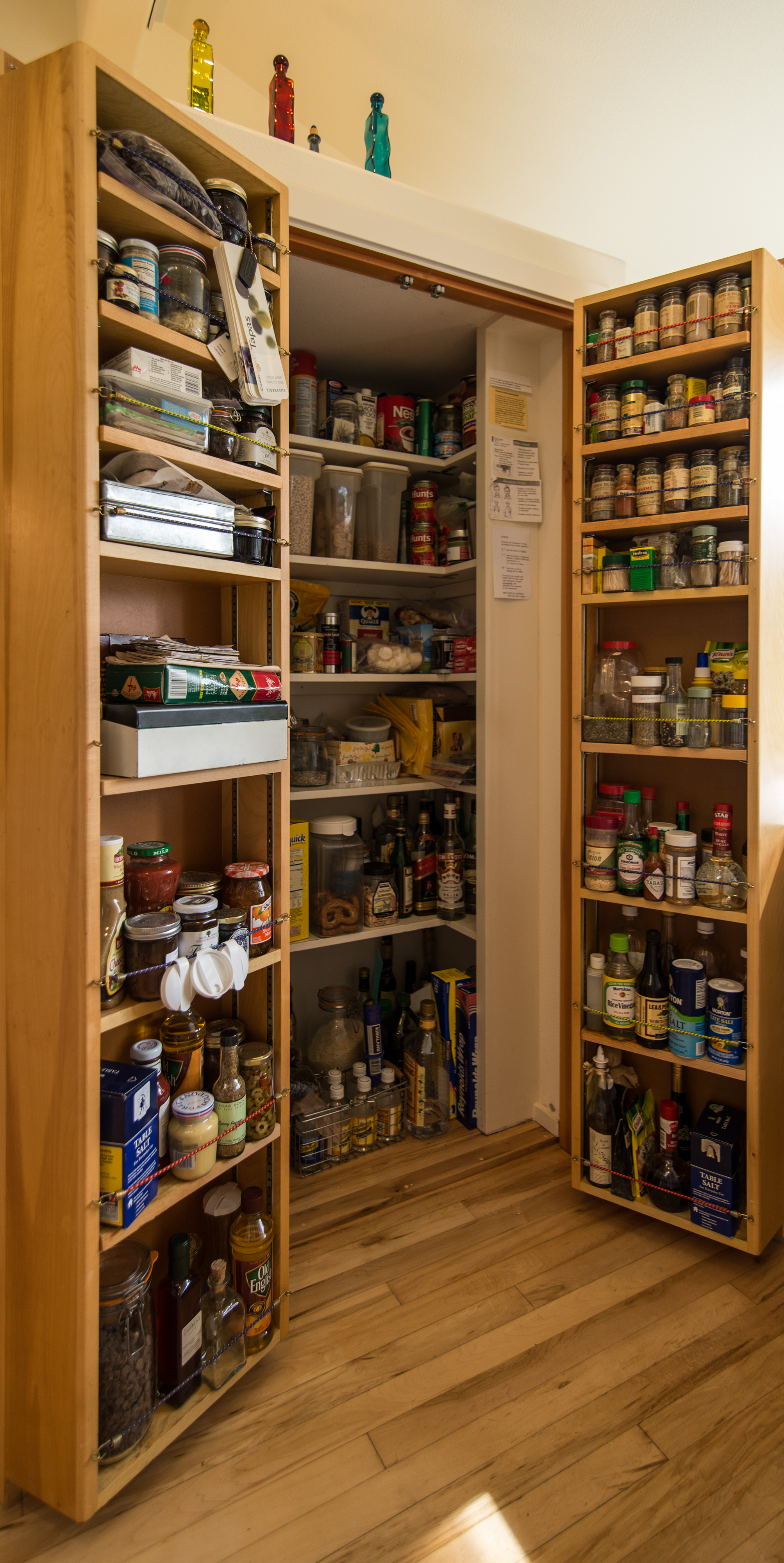 Ed's pantry idea.......never seen so much stuff go into such a small area. Shelves on doors close into interior pantry area.