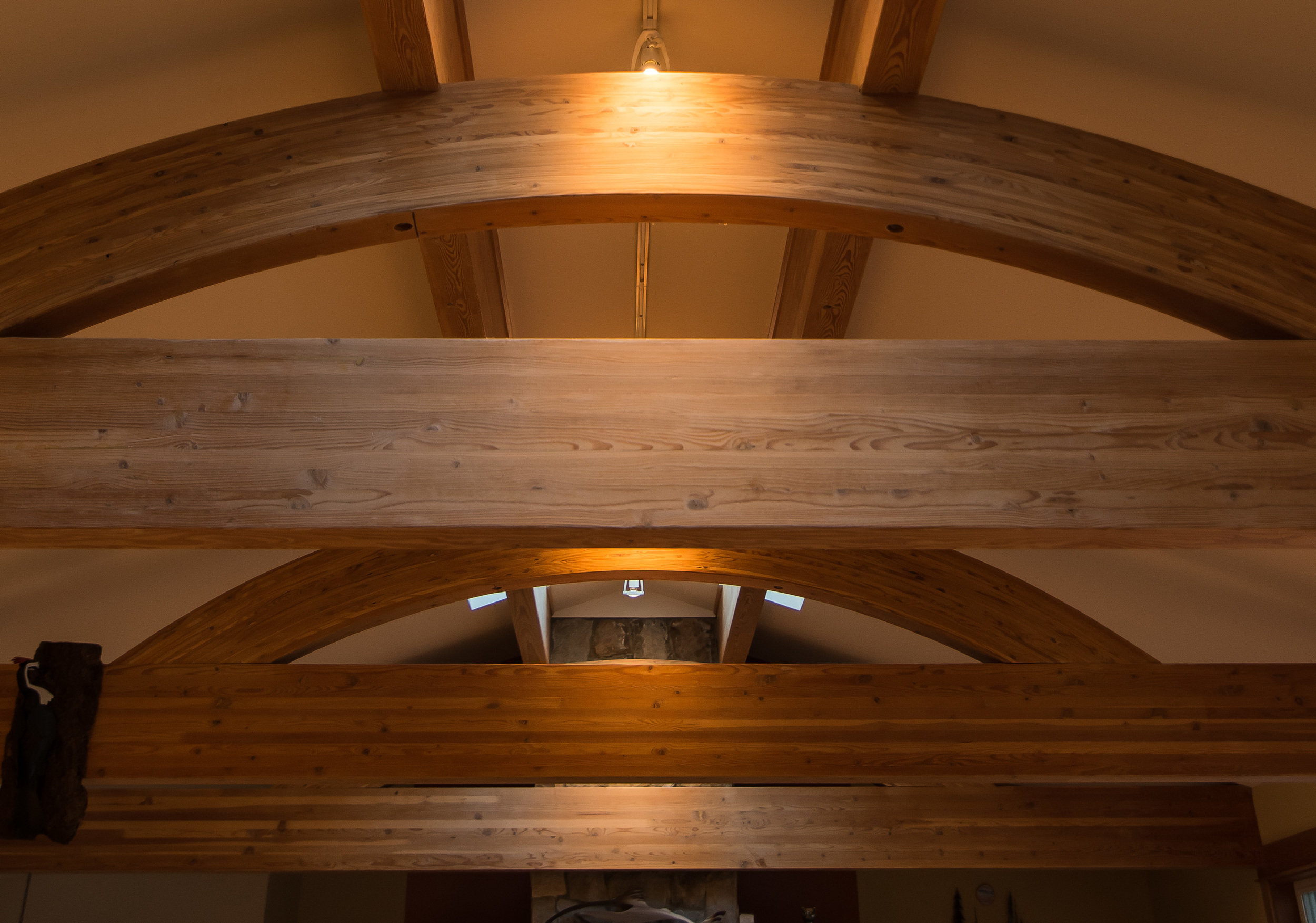 Arched Glulams support pair of ridge beams