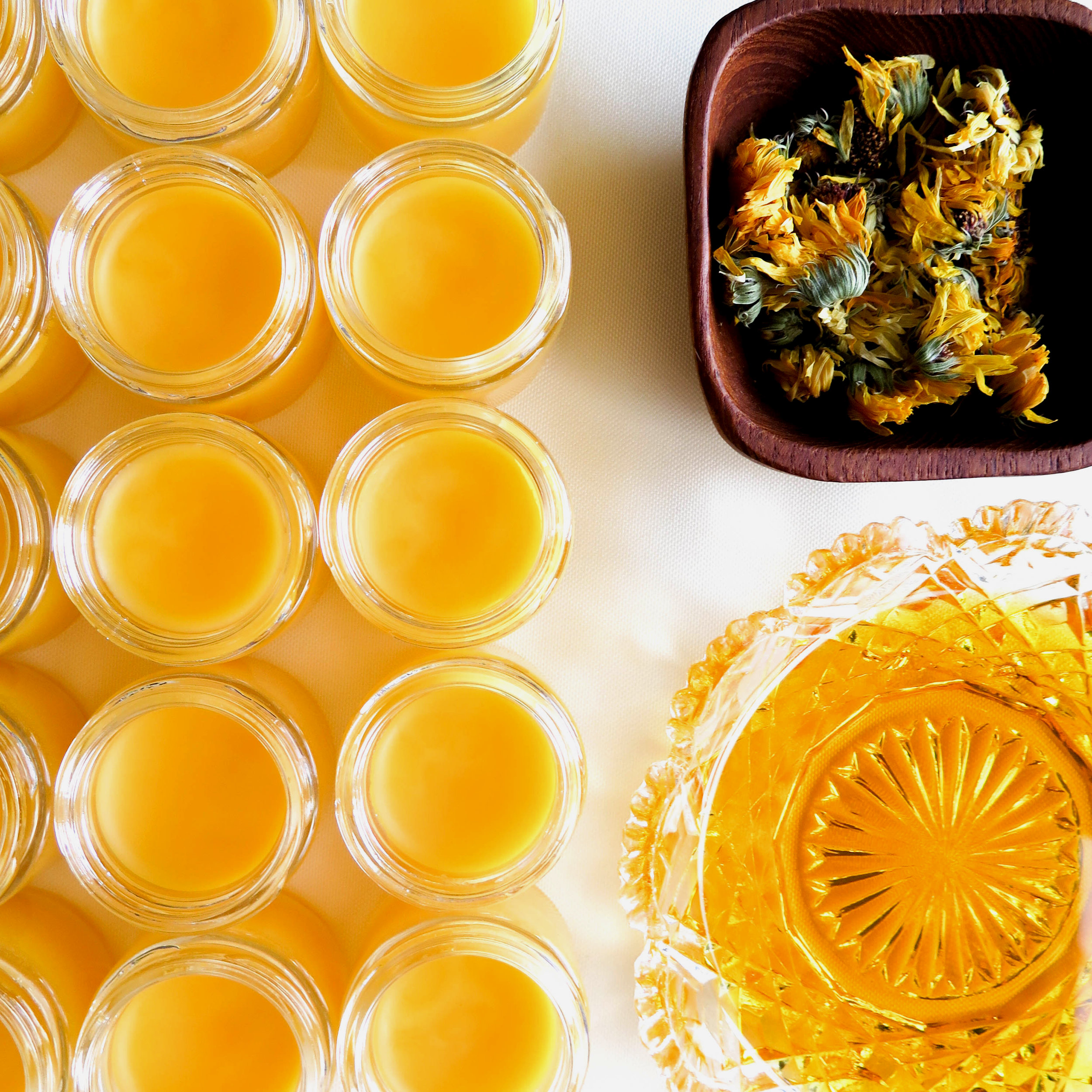 calendula salve with flowers and oil square.jpg