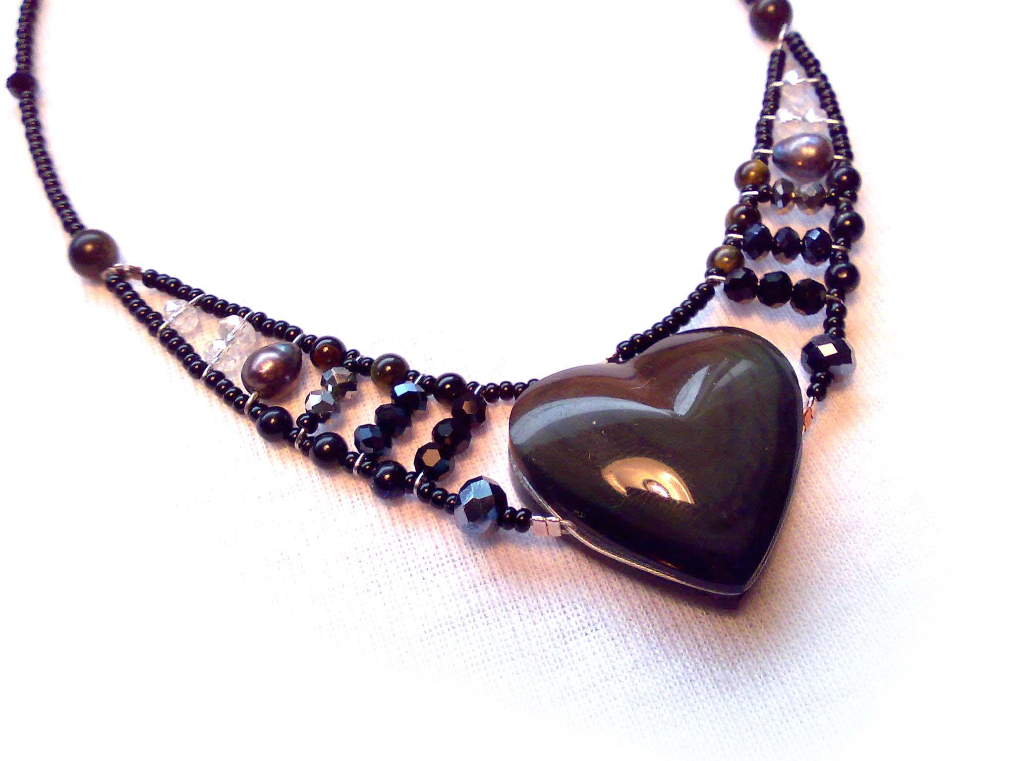 Obsidian, Tiger's Eye, Freshwater Pearl, Swarovski Crystals, Sterling Silver branded tag.