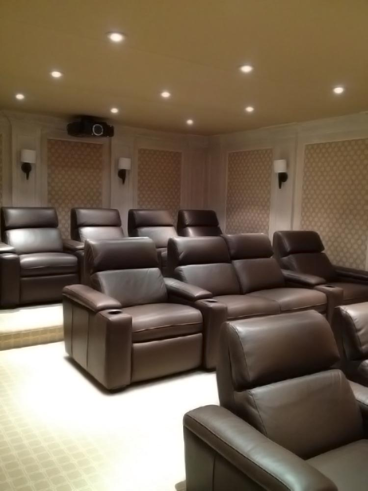 Warm Inviting Home Theater NY Brown Leather Chairs.jpg
