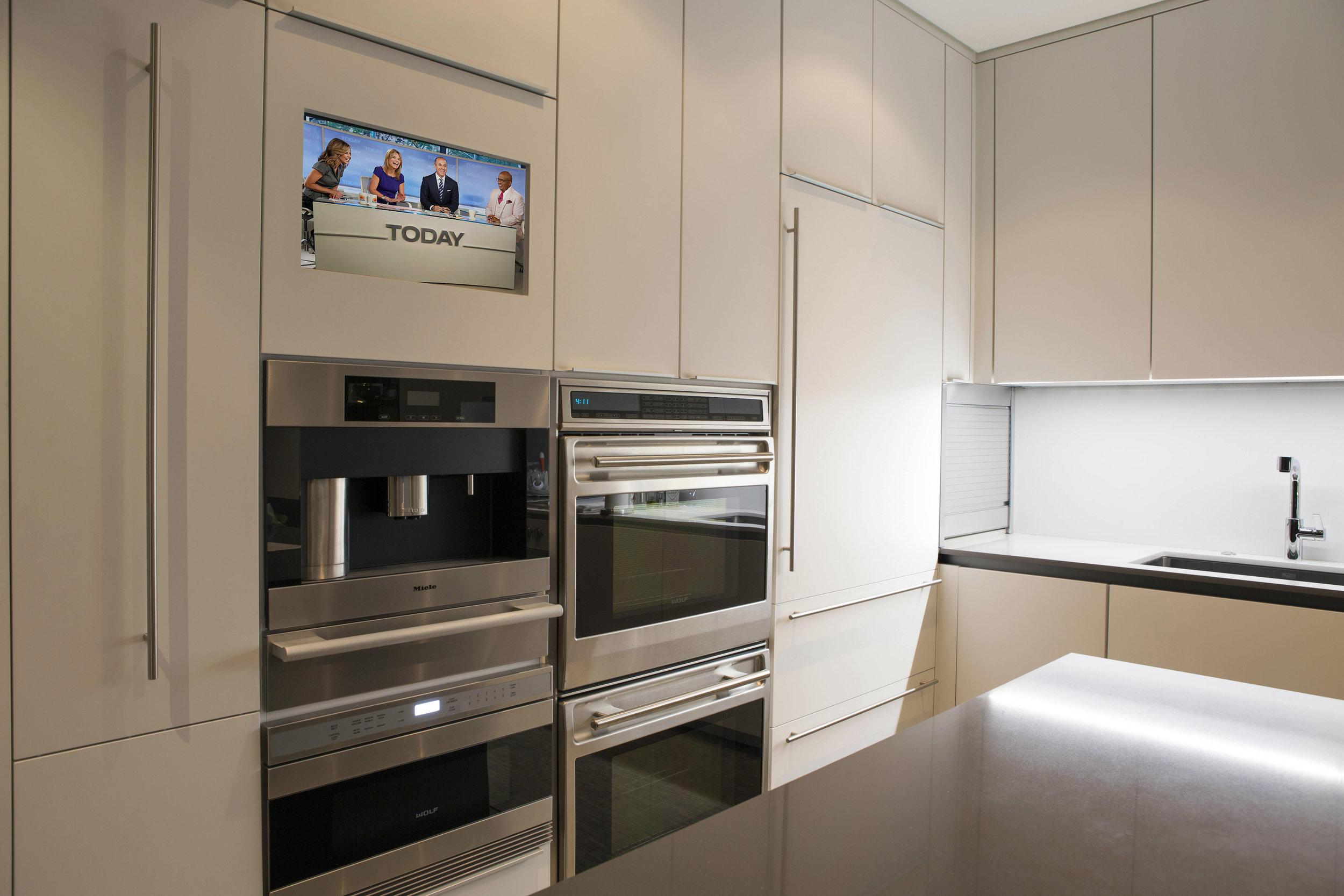 Kitchen with sink TV on.jpg