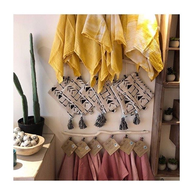 Check out this pretty display featuring my dishtowels at the soon to be open @goldenfinchboutique! 🌿💛