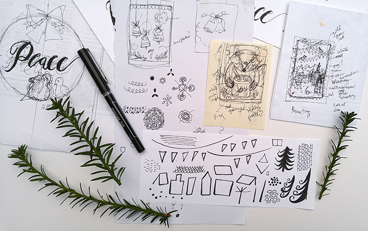 Can you spot some of my thumbnail sketches? I have a wreath on the left, some bells, a fox with cocoa, and a little village. Other bits of doodles are sketches for fun and some sprigs of pine for reference.