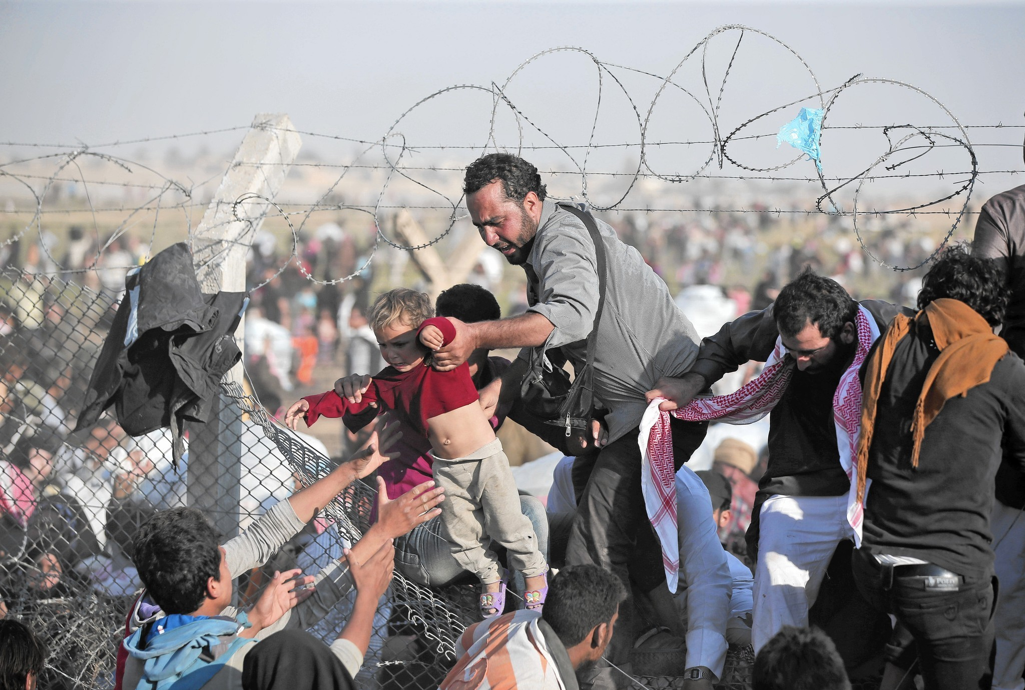 mc-pa-accept-syria-refugees-wolf-20151116.jpg
