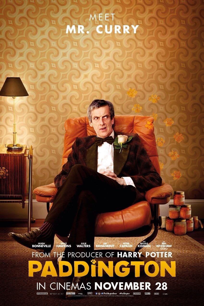 Looking grumpy, Peter Capaldi as Mr Curry