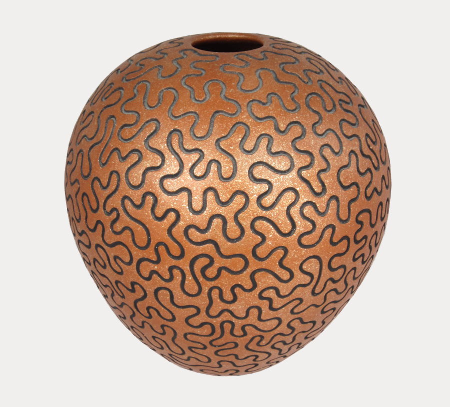San Felipe puzzle pot by Herbert Candelario, 1995. https://www.marcyburns.com/pottery-collection/san-felipeo-pueblo-pot-by-herbert-candelario