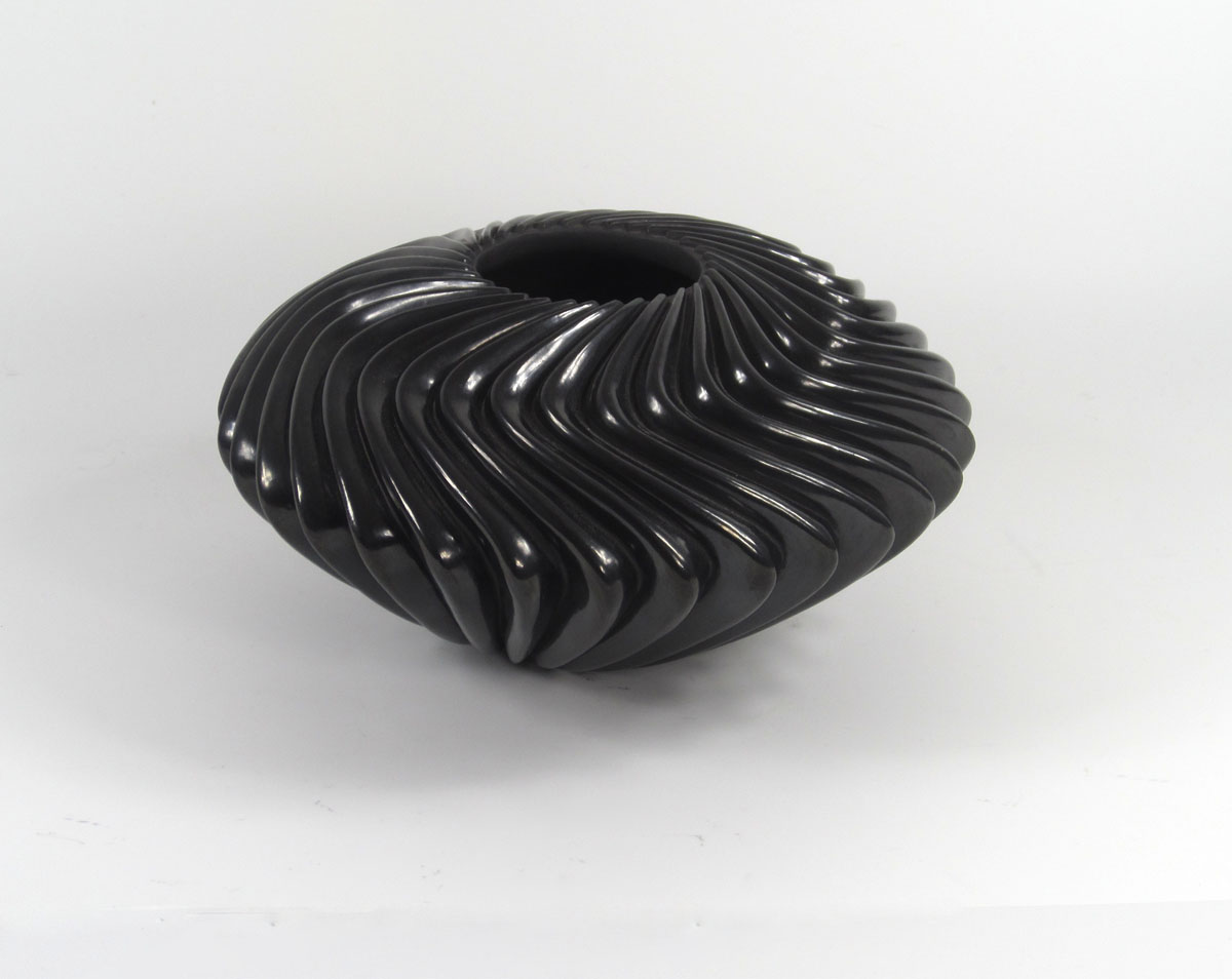 """s"" shaped melon bowl by Nancy Youngblood Lugo"