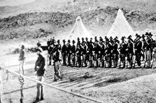 US Army at Gillems Camp, Lava Beds National Monument, 1873, representative of what Stapleton would have been doing around that time. Photographer unknown, archived by NPS.
