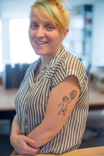 Kate Robinson, Curatorial Assistant at the Letterforms Archive sporting her pressmark on her left arm.