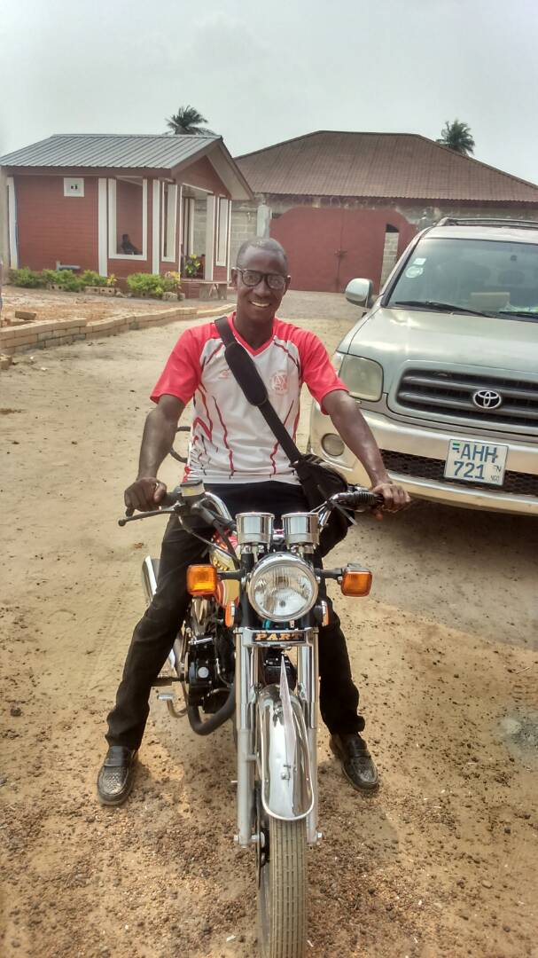 Pastor Pious on his new motorcycle after a generous donor helped him replace the one he sold to be able to purchase the land! -