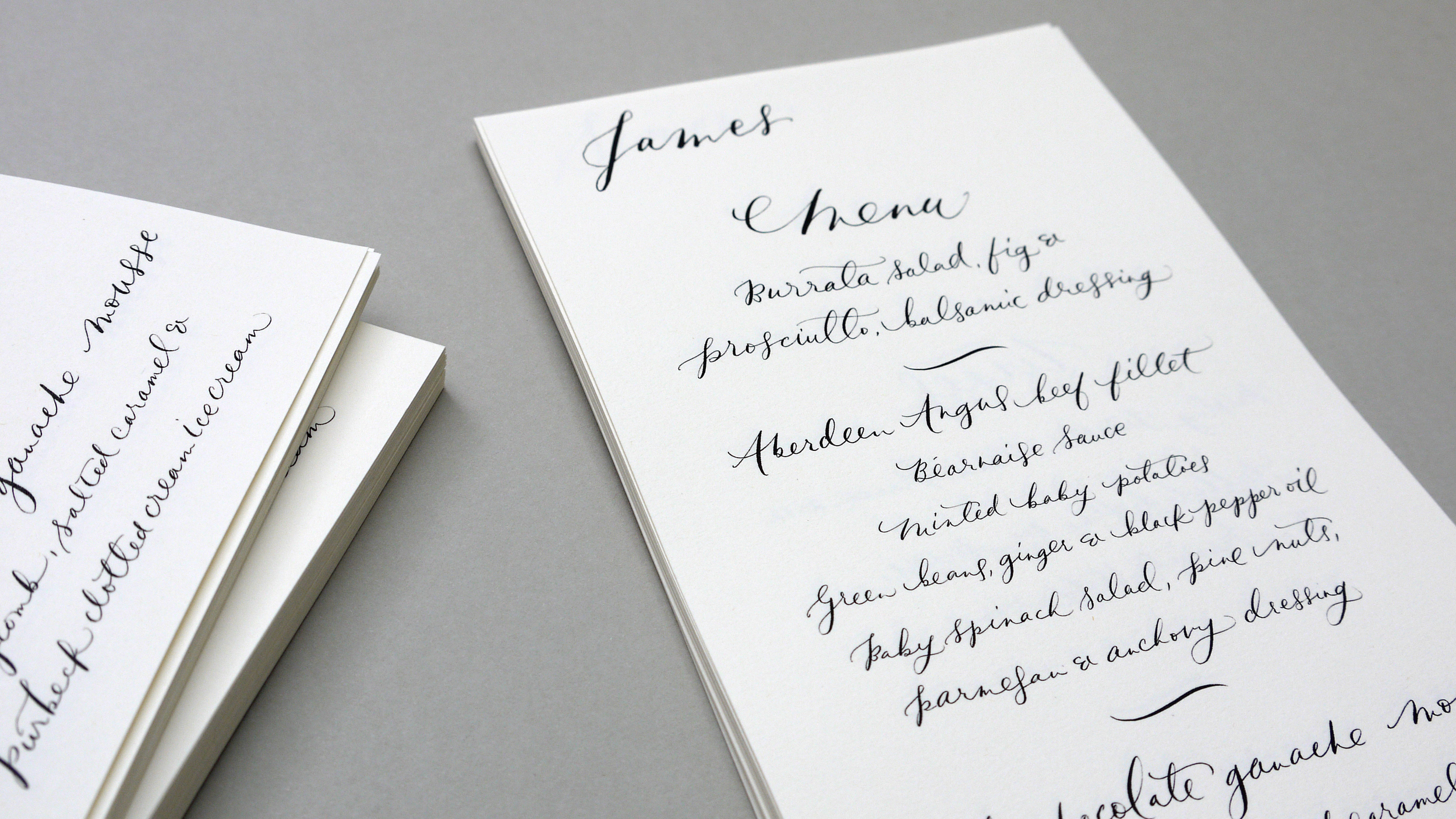 Custom menu calligraphy with guests names