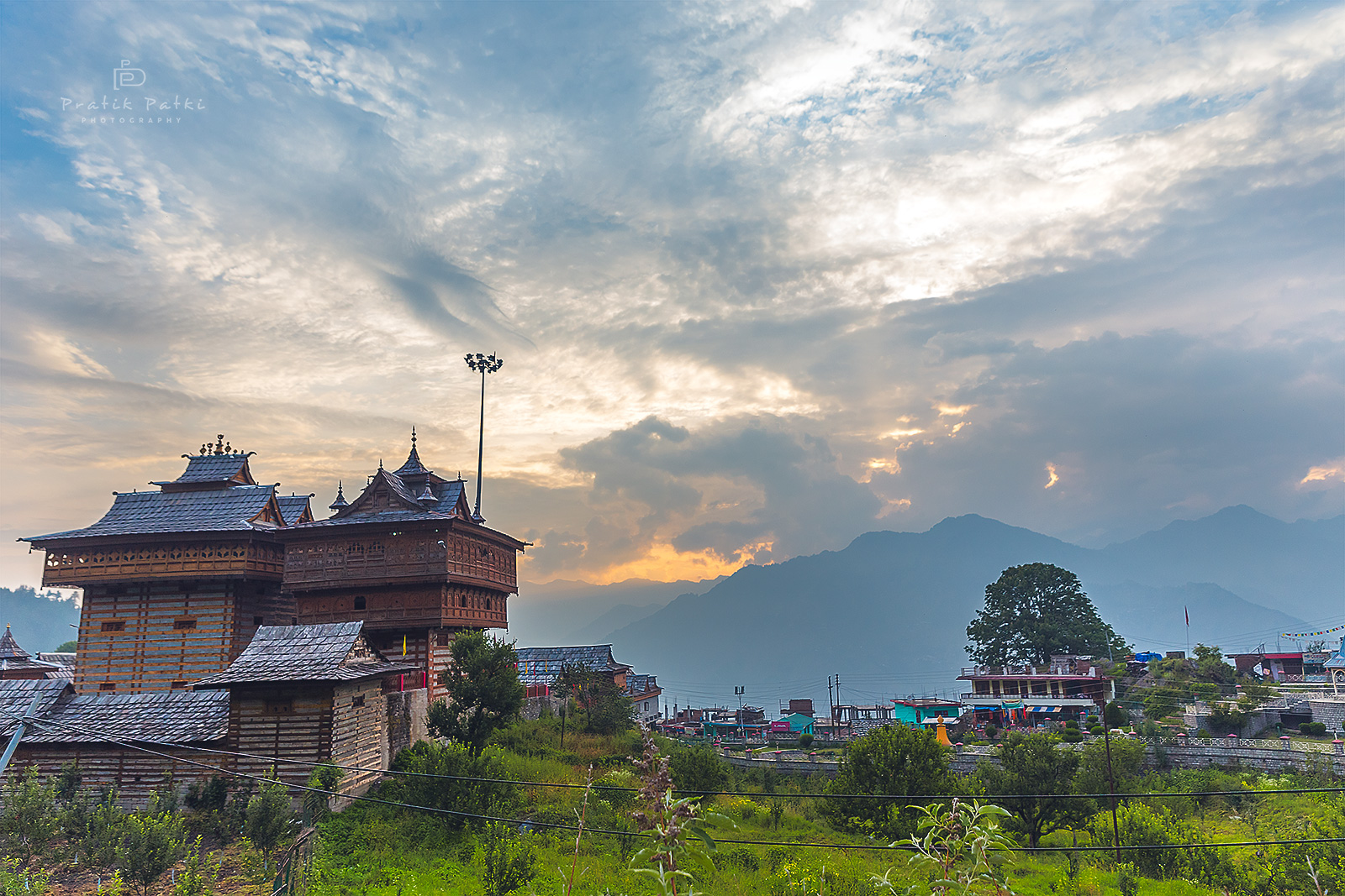 A beautiful evening comes to an end. The temple stands tall amidst the smaller houses and the sunset sky