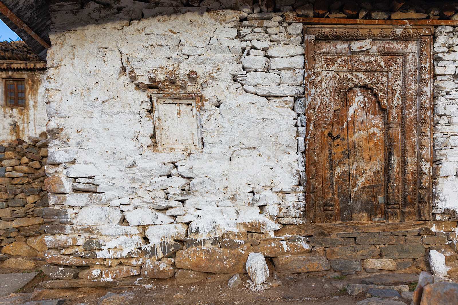 An old temple with a worn down wall