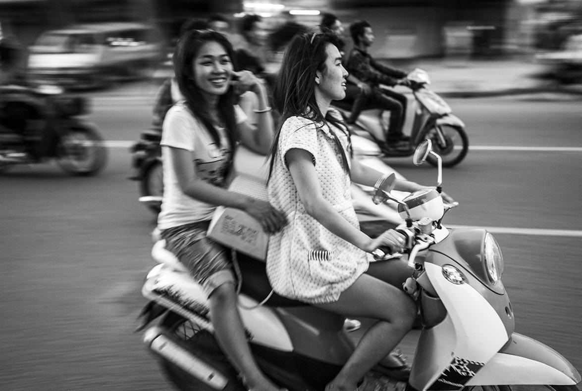 Easy riders, where helmets are optional. Cambodia.
