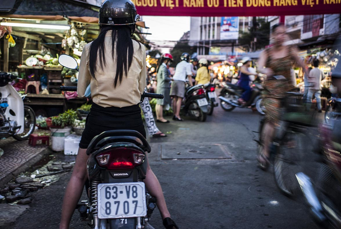 Ride-through shopping at the fresh produce market, Saigon, Vietnam.