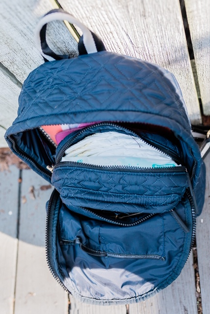 The Departure Backpack with the Stowaway tucked inside (both in Marina).