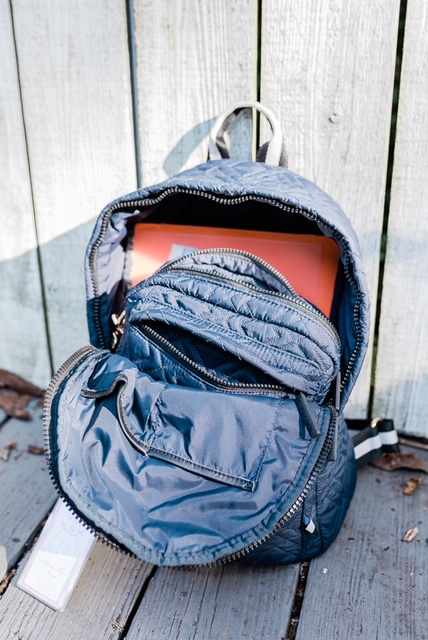 The Stowaway has strategic zippered pockets on the outsides—so smartly designed!