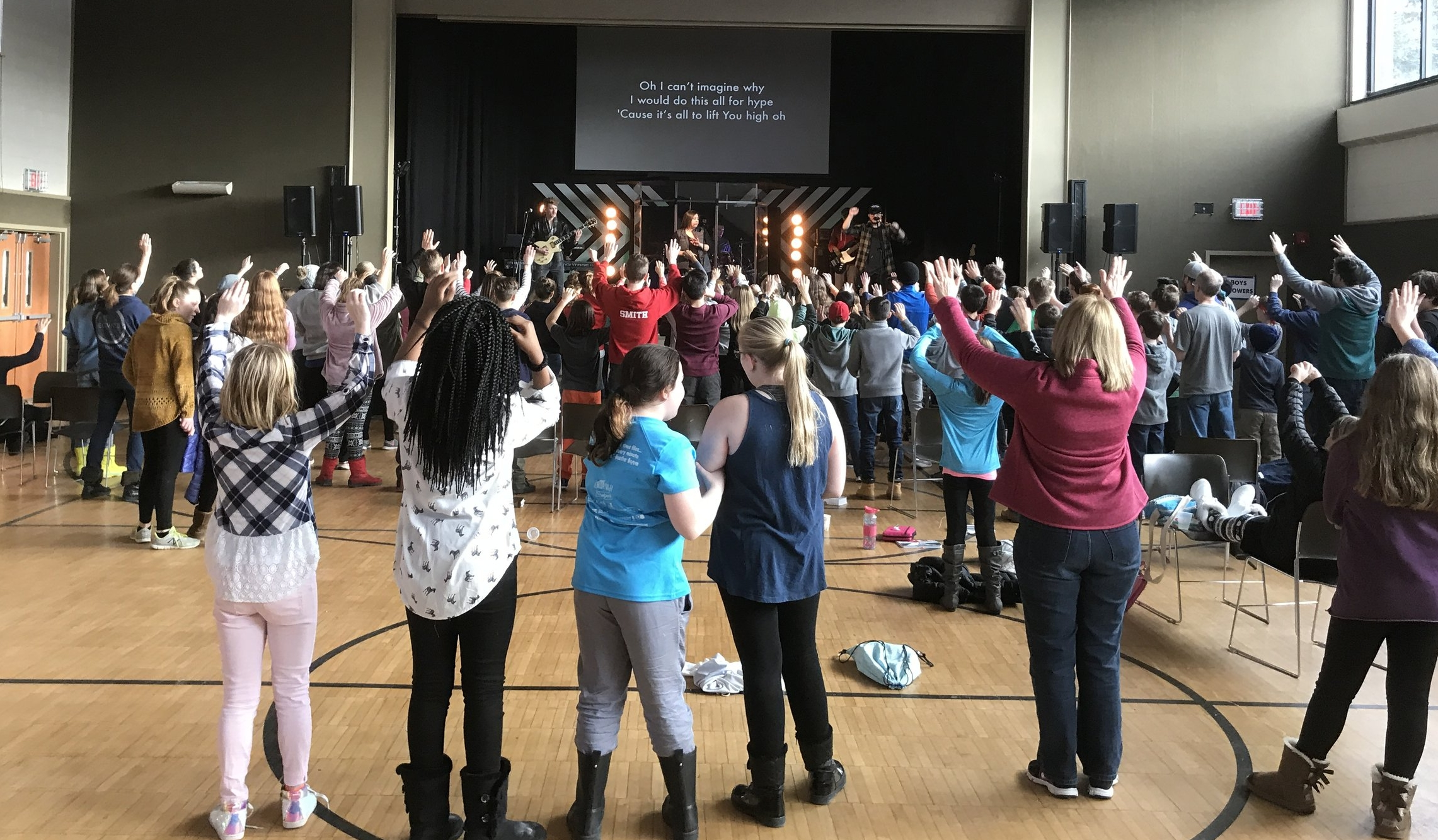 Pretty cool to see students all over the gym lifting their hands in worship!