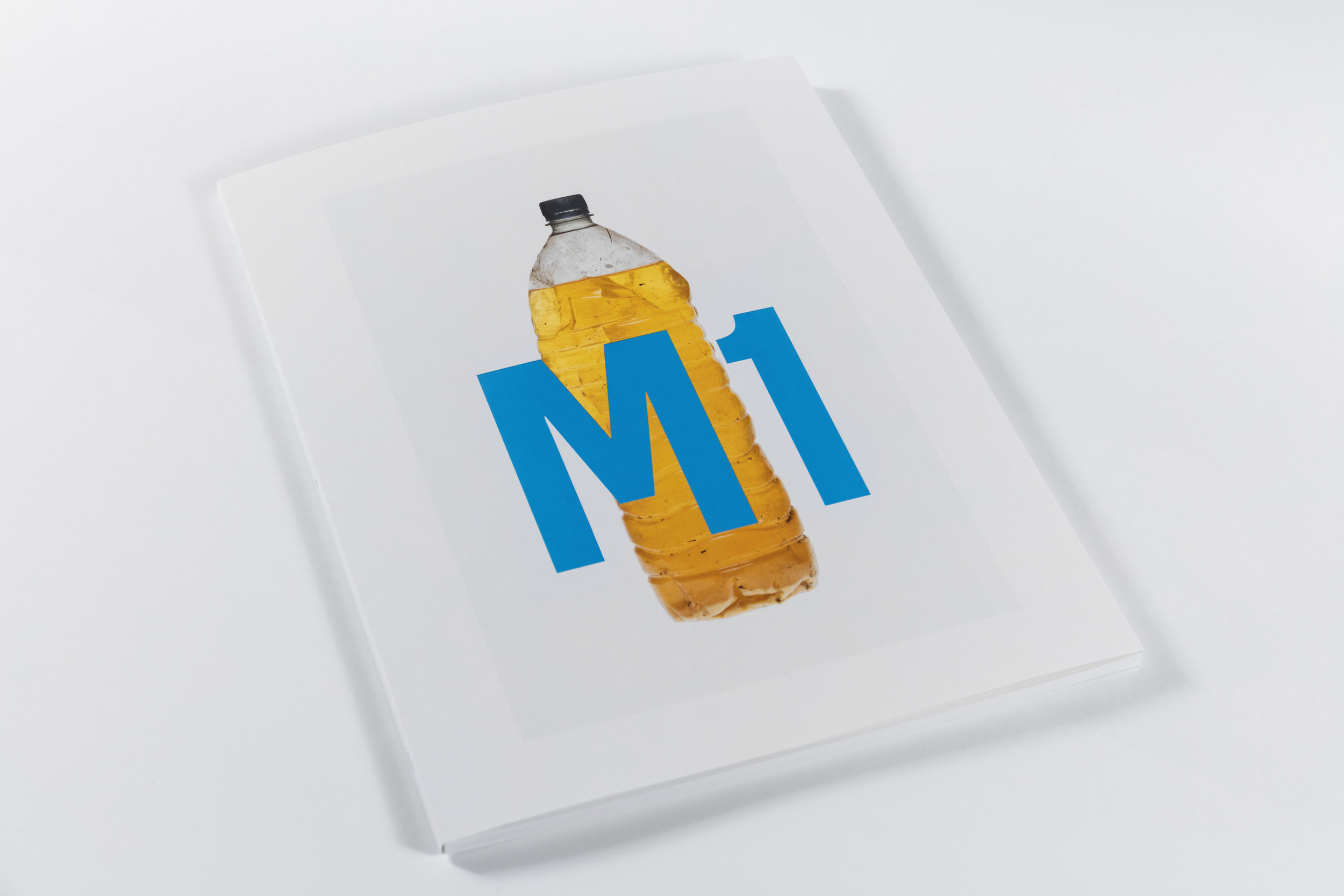 M1 - A travelogue narrated through bodily effluent. A motorway journey described in the call and response of the full bladder.A British road movie – Two Lane Blacktop and Wild At Heart reduced to a trail of piss-filled plastic bottles.Book Title - M156 pp / 320 x 240mmLitho 4-colour processEmbossed cover titleFold out 8 page softcoverOpen spine - Swiss bindingMatt coated art paper.LTD edition of 300 (signed copies)Published by AuditFirst printing April 2018ISBN 978-1-5272-1788-1