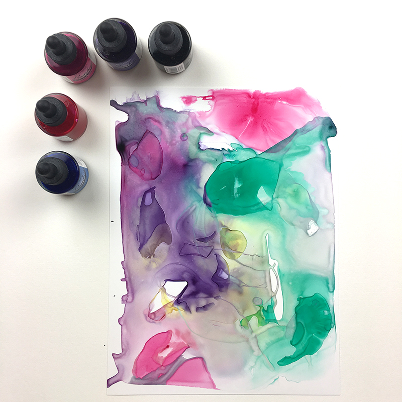 Dropping ink into water on yupo paper.