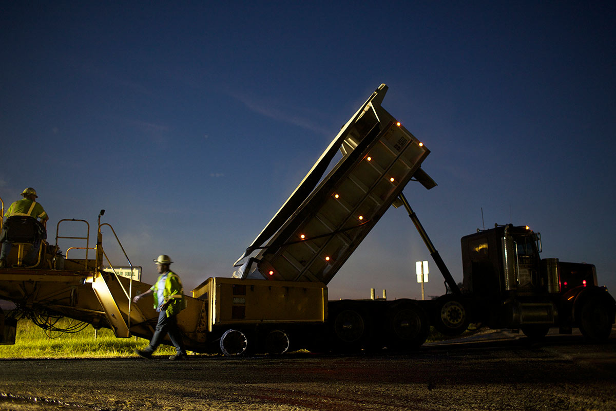 Caterpillar heavy machinery used on a night paving job by Boxely.