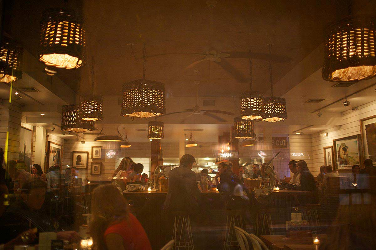 Photograph of a busy restaurant at night.
