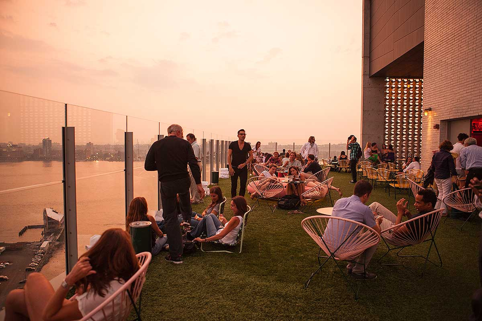 People gather on the roof top deck of the Standard in New York City.