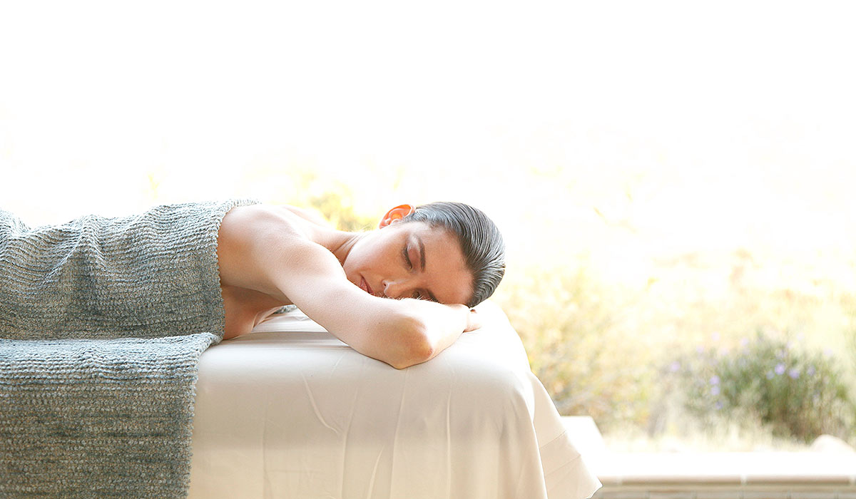 An advertising image used for spa treatment or massage marketing.