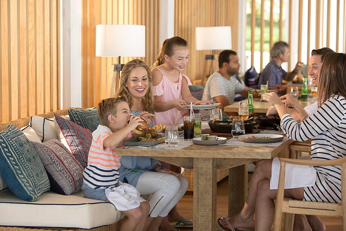 Campaign for a resort showing a family enjoying lunch at an upscale restaurant.