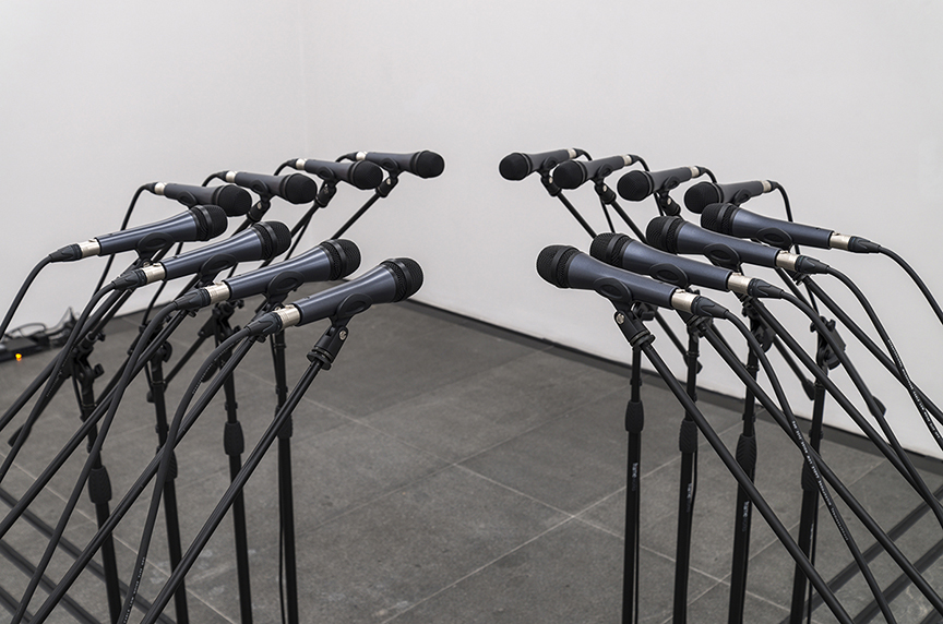 Barricade , 2016 (Detail). 16 microphone and microphone stands and matching audio equipment (mixer, EQ etc.) , Variable dimensions. Photo by Cary Whittier.