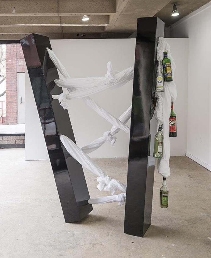 Sweat 4 (Tali) , 2015,Liquor bottles, bed sheets, metal, painted wood, 63'' x 84'' x 13''