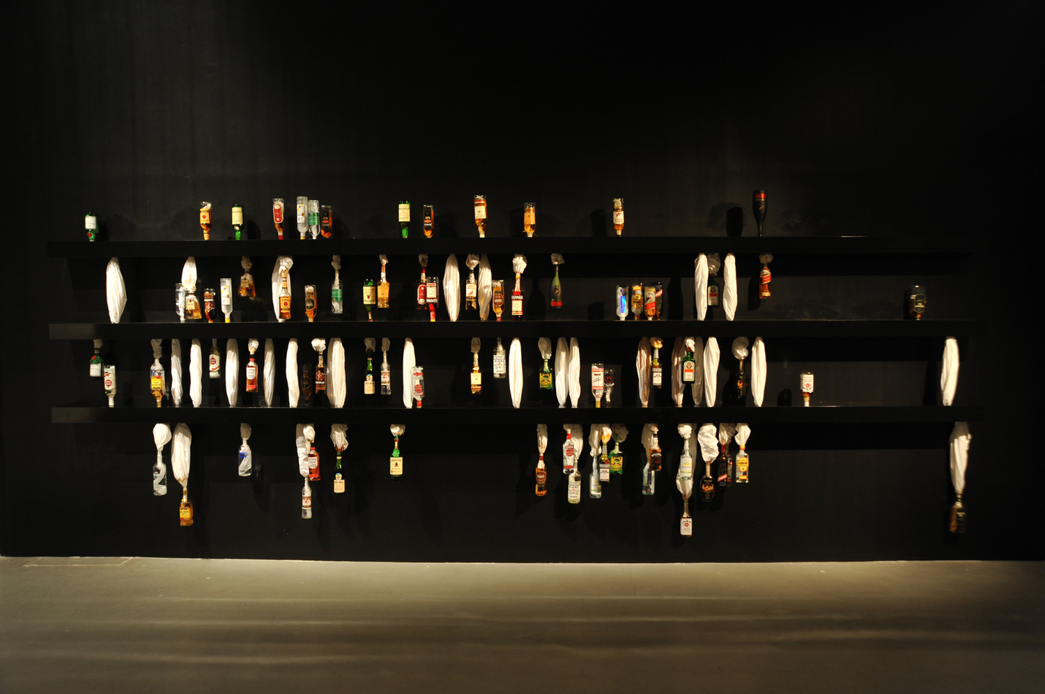 SWEAT , 2010, Full liquor bottles, bed sheets and shelves, Dimensions variable