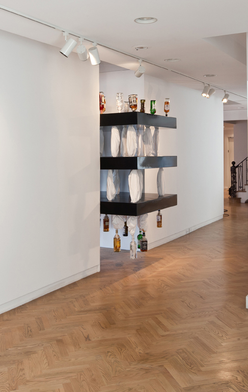 SWEAT (2) , 2011, Bed sheets, liquor bottles,MDF, Dimensions variable.From the exhibition  Involuntary curated by  Neville Wakefield .