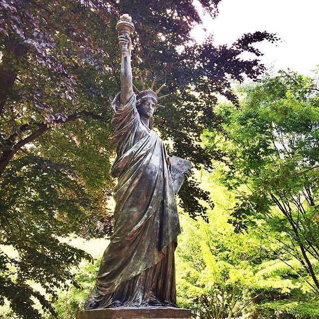 A small version of the Statue of Liberty in a park in Paris. France you have inspired us in so many ways. #peace