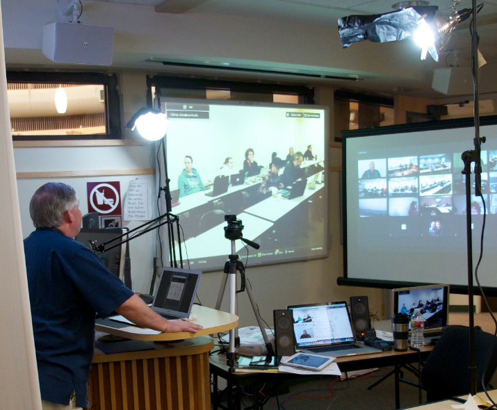 Faulty member Brian Van Dyke teaches via videoconference to teacher candidates participating as groups and individuals throughout the state.