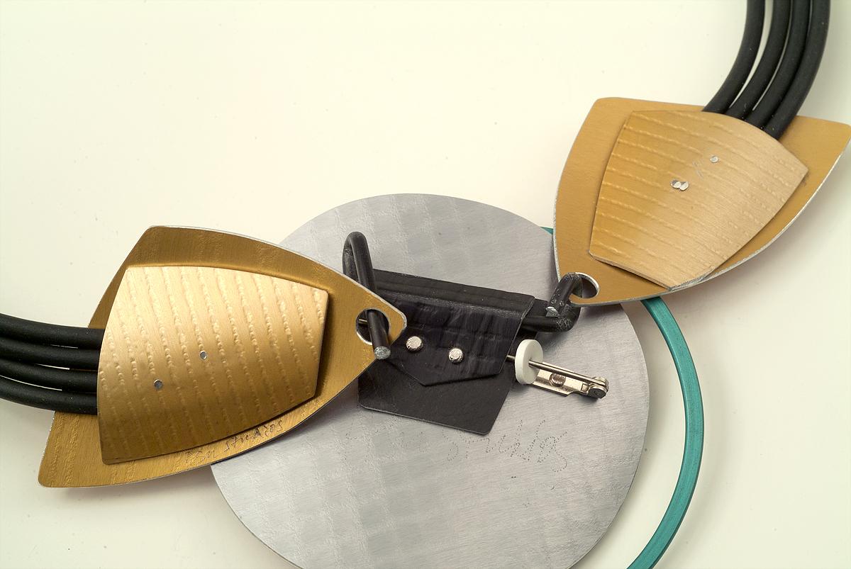 5. Slide end of neckpiece onto long hook.